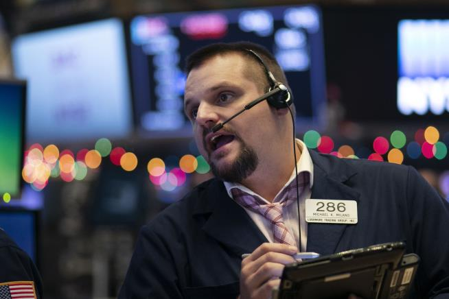 Wall Street rises in volatile trading led by defensive stocks