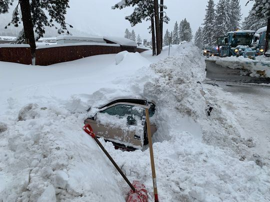 Snowplow Hits Buried Car, Then a Bigger Surprise