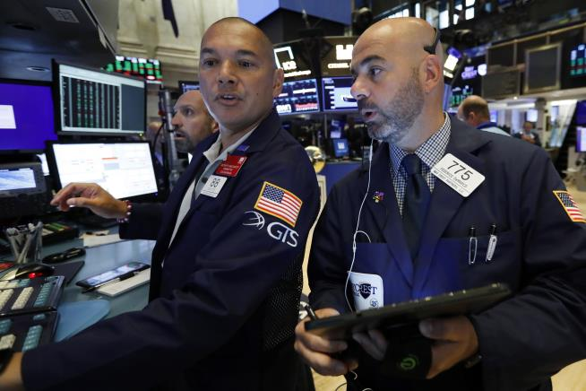 Wall Street eases from record highs as tech drags; Fed meeting eyed