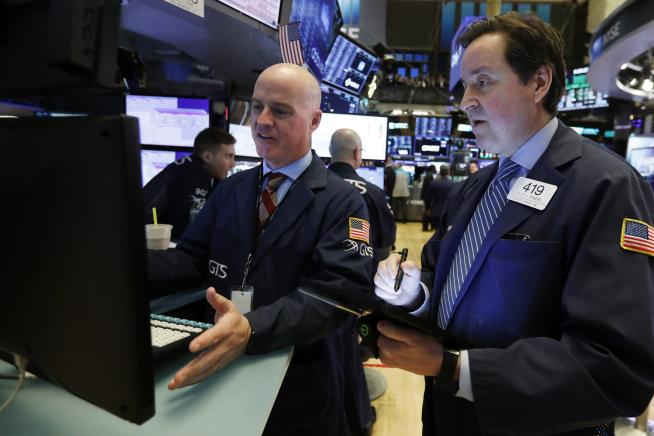 Wall St eases from record highs on coronavirus concerns, Cisco results