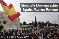 Moody's Downgrades Spain, Warns France