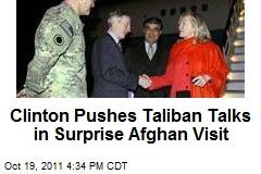 Clinton Pushes Taliban Talks in Surprise Afghan Visit