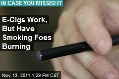 E-Cigs Work, But Have Smoking Foes Burning