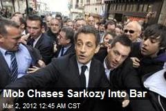Mob Chases Sarkozy Into Bar