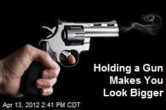 Holding a Gun Makes You Look Bigger