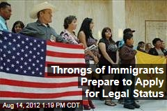 Throngs of Immigrants Prepare to Apply for Legal Status
