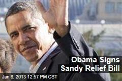 Obama Signs Sandy Relief Bill