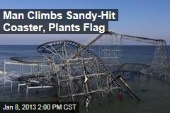 Man Climbs Sandy-Hit Coaster, Plants Flag