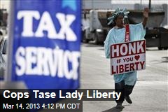 Cops Tase Lady Liberty