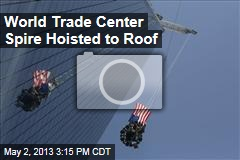 World Trade Center Spire Hoisted to Roof