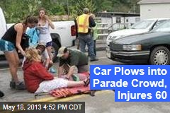 Car Plows into Parade Crowd, Injures 60