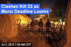 Clashes Kill 23 as Morsi Deadline Looms