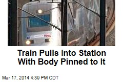 Train Pulls Into Station With Body Pinned to It