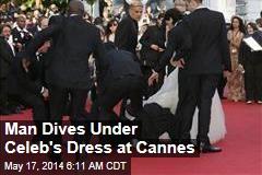 Man Dives Under Celeb's Dress on Cannes Red Carpet