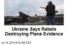 Ukraine Says Rebels Destroying Plane Evidence