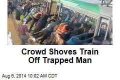 Crowd Just Shoves Train Off Guy Stuck in Gap