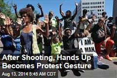 After Shooting, Hands Up Becomes Protest Gesture