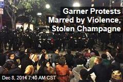 Garner Protests Marred by Violence, Stolen Champagne