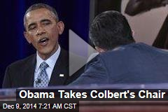 Obama Takes Colbert's Chair