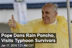 Pope Dons Rain Poncho, Visits Typhoon Survivors