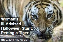 Woman's Ill-Advised Halloween Stunt: Petting a Tiger