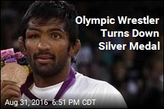Olympic Wrestler Turns Down Silver Medal