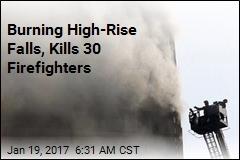Burning High-Rise Falls, Kills 30 Firefighters