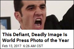 Assassin's Defiant Stance Is World Press Photo of the Year