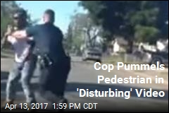 Cop Pummels Pedestrian in 'Disturbing' Video