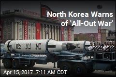 North Korea Parades Missiles, Warns of War