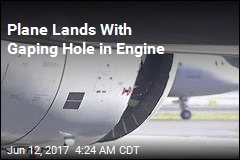 Plane Lands With Gaping Hole in Engine
