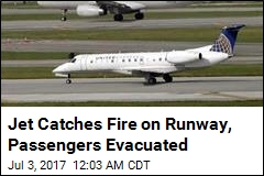 Jet Catches Fire on Runway, Passengers Evacuated