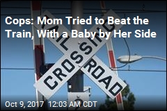 Cops: Mom Rescued Baby Seconds Before Train Hit SUV