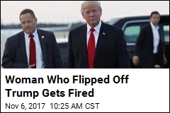 Woman Who Flipped Off Trump Gets Fired