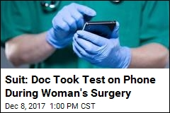 Suit: Doc Took Test on Phone During Woman's Surgery