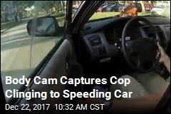 Body Cam Captures Cop Clinging to Speeding Car