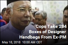 Cops Take 284 Boxes of Designer Handbags From Ex-PM