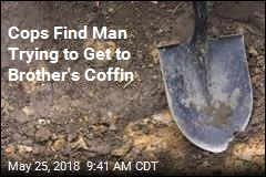 Cops Find Man Digging Up Brother's Grave