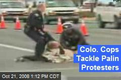 Colo. Cops Tackle Palin Protesters