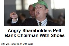 Angry Shareholders Pelt Bank Chairman With Shoes
