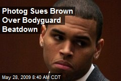 Photog Sues Brown Over Bodyguard Beatdown