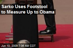 Sarko Uses Footstool to Measure Up to Obama