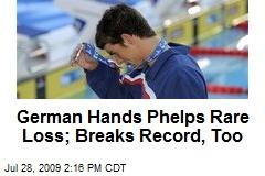 German Hands Phelps Rare Loss; Breaks Record, Too