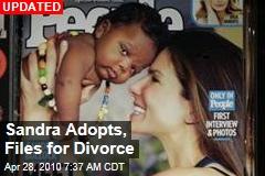 Sandra Adopts, Files for Divorce