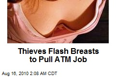 Thieves Flash Breasts to Pull ATM Job