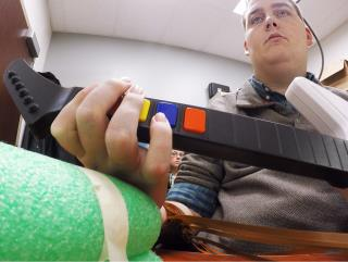 Brain Implant Lets Paralyzed Man Use His Hand Again