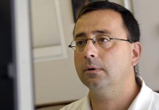 Ex-USA Gymnastics Doc Denies Abuse Charges