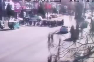 Car Strikes Crowd Outside China School