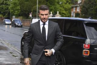 David Beckham Uses Phone While Driving, Now Can't Drive