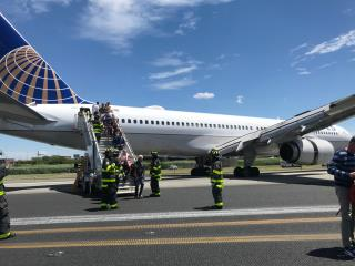 Plane Blows Tires, Skids Down Runway